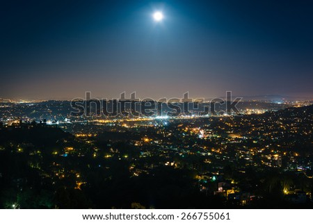 The moon over Northeast Los Angeles at night, seen from Griffith Observatory, in Griffith Park, Los Angeles, California. - stock photo