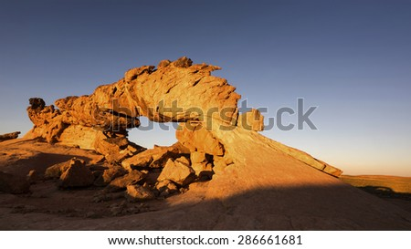 The moon over Sandstone Bridge on the earth. Grand Staircase-Escalante National Monument, UT - stock photo