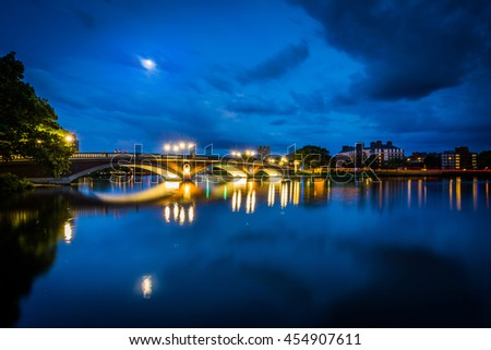 The moon over the John W Weeks Bridge and Charles River at night, in Cambridge, Massachusetts. - stock photo