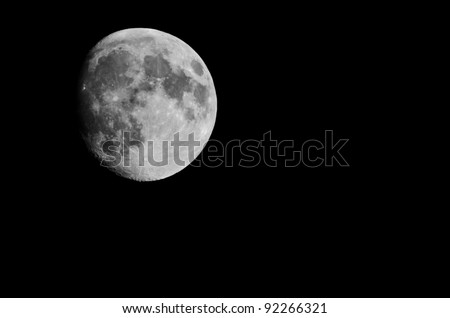The moon seen from earth isolated over black - stock photo