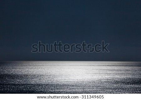 The Moonlight gives a sparkleto the calm waters of the Mediterranean Sea - stock photo
