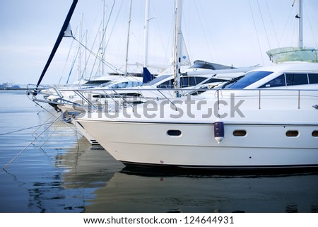 The moored yachts stand on an anchor. - stock photo