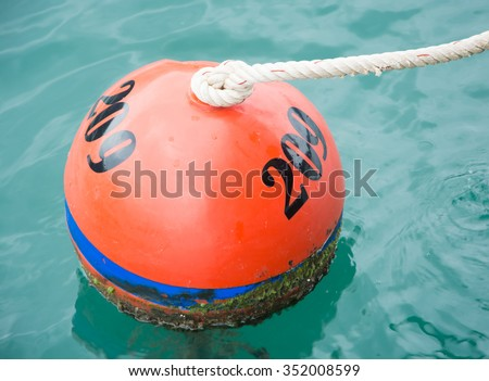 THE MOORING BUOY FOR MARKING UP RESTRICTED AREA OF NO ANCHOR ZONE NEAR CORAL REEF AREA UNDERSEA - stock photo