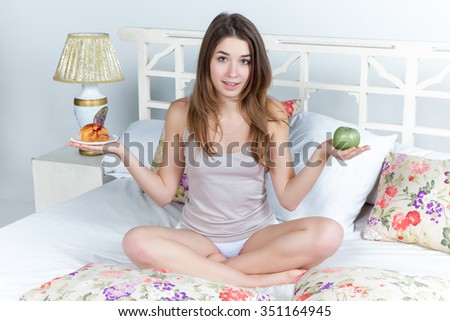 The morning and breakfast of young beautiful girl in bed at home.  concept of healthy and useful food