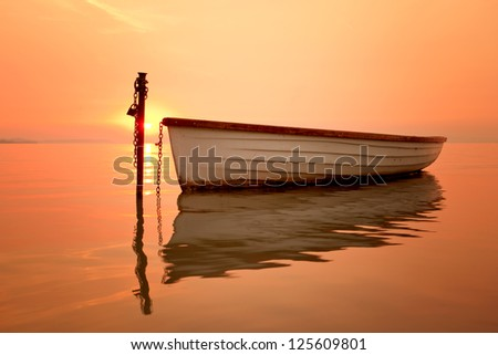 The morning of the lake, the boat docked on the lake - stock photo