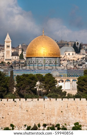 The morning sun shines on the golden Dome of the Rock and church steeples on the skyline of the Old City of Jerusalem.