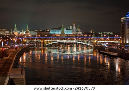 The Moscow Kremlin at night. View of the Moscow Kremlin and the Bolshoy Kamenny bridge at night.