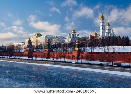 The Moscow Kremlin is reflected in the Moscow river with floating ice - stock photo
