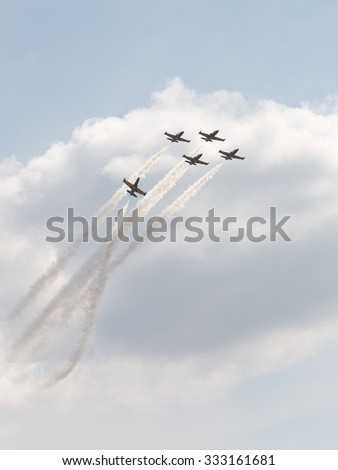 """The Moscow region - August 28 2015: aerobatic team """"Rus"""" on combat training aircraft L-39 Albatros performs aerobatics Max on August 28, 2015, Zhukovsky, Moscow Region, Russia - stock photo"""