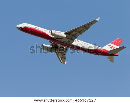 The Moscow region - July 31, 2016: White and red passenger plane TU-204-100BE Red Wings Airlines flies to Domodedovo airport July 31, 2016 Moscow Region, Russia