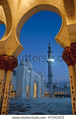 The mosque comes alive at the call of prayer. The Muslims pray five times a day. Seen here is the minaret from where the call for prayer is done, - stock photo