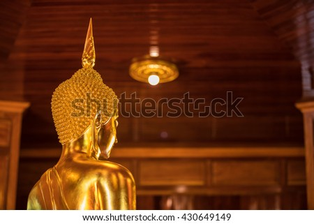The Most Beautiful Golden Buddha ; backside of Gold face Buddha statue at public worship, Thailand - stock photo