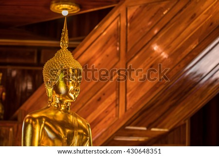 The Most Beautiful Golden Buddha ; Gold face Buddha statue at public worship, Thailand - stock photo