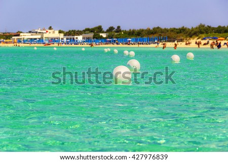 The most beautiful sandy beaches of Apulia:Porto Cesareo marine,Salento coast.ITALY (Lecce).It is a tourist resort thanks to its sunny beaches extending for 17 kilometres and its clear waters. - stock photo