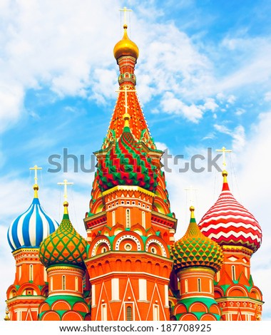 The most famous architectural place for visiting and attraction in Moscow, Russia, Saint Basil's cathedral with colorful vivid cupolas and spectacular domes in traditional culture on cloudy blue sky - stock photo