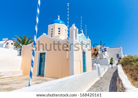 The most famous church on Santorini Island,Crete, Greece. Bell tower and cupolas of classical orthodox Greek church with view of Mediterranean sea and Spinalonga island - stock photo