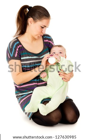 the mother feeds her baby isolated on white background