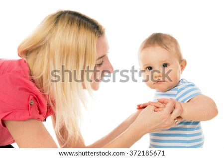 The mother plays her child on a white background