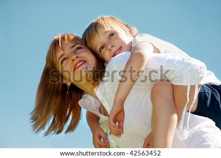 The mother with small son against sky - stock photo