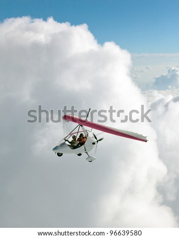 The motor hang-gliding in the sky near the himalayan peaks Machhapuchre - Nepal - stock photo