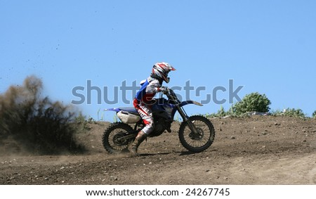 The motorcyclist aspires to finish, overcoming obstacles - stock photo