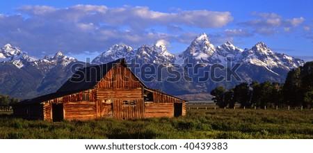 The Moulton Barn and the Teton Range in Grand Teton National Park, Wyoming. - stock photo