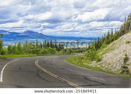 The mountain highway through the Canadian Rockies near Waterton Lakes National Park. - stock photo