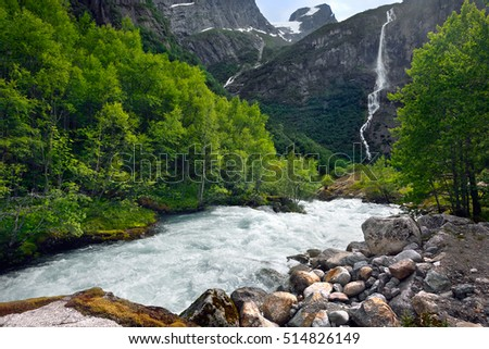 The mountain river flowing from a glacier, Norway