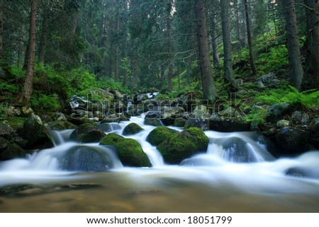 The mountain river in Rila mountains in Bulgaria - stock photo