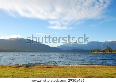 The mountains and lake under the blue sky