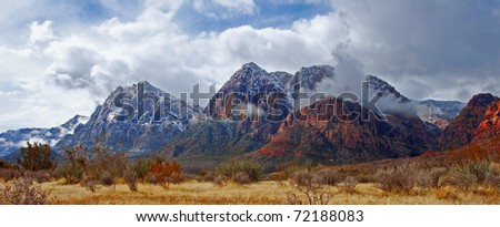 The mountains of Red Rock Canyon State Park, Nevada after an early morning snowfall. - stock photo