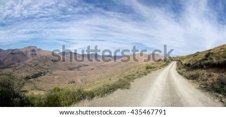 The mountains of the Eastern Cape stretch off into the distance, promising adventure - stock photo