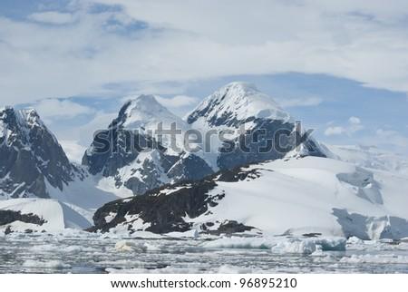 The mountains on the coast of the Antarctic Peninsula - 3. - stock photo