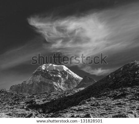 The mountains peak Gyachung Kang (7952 m) with beautiful clouds - Gokyo region, Nepal (black and white) - stock photo
