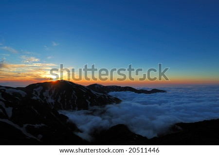 The mountains where a cloud is boiled - stock photo