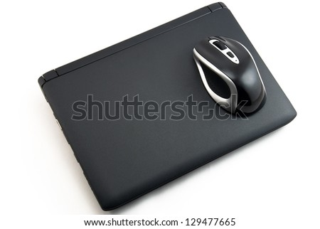 The mouse on the laptop - stock photo