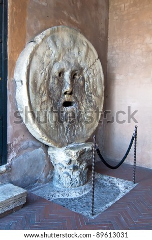 The mouth of truth, in Italian: Bocca della Verita, is an old marble mask on the wall of the Church of Santa Maria in Cosmedin in Rome in 1632. - stock photo