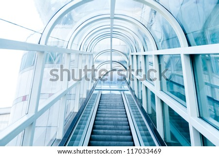 the moving escalator - stock photo