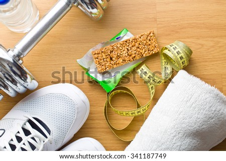 the muesli bar and sport equipment - stock photo