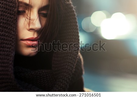 The mysterious thoughtful woman in a hood - stock photo