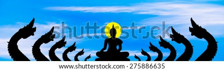 The naga black silhouette and the Buddha on gblue sky cloud background - stock photo