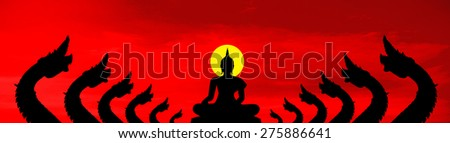 The naga black silhouette and the Buddha on red cloud background - stock photo