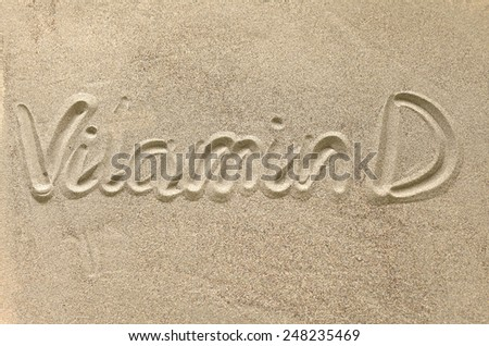 the name and designation drawn in the sand