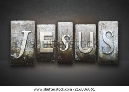 The name JESUS written in vintage letterpress type - stock photo