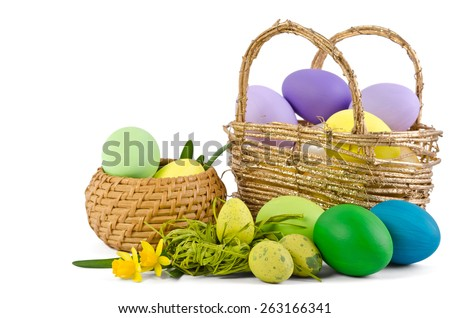 The Narcisse  and eggs for easter in in wicker warel isolated on white background - stock photo