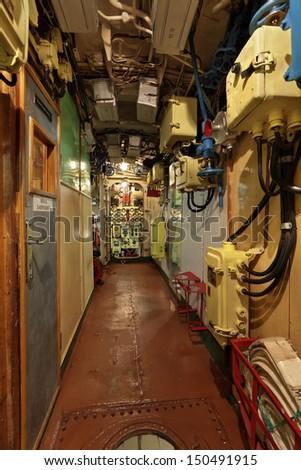 The narrow corridor of the old submarine - stock photo