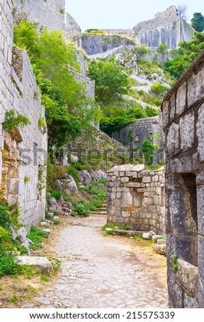 The narrow footpath along the ramparts leads to the mountain top with the upper part of the fortress of St John, Kotor, Montenegro.