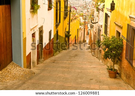 The narrow, hillside  streets of colorful San Miguel Allende Mexico - stock photo