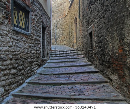 the narrow street in old city of Bergamo, Italy - stock photo