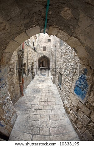 The narrow street in the Arab quarter of Jerusalem. - stock photo